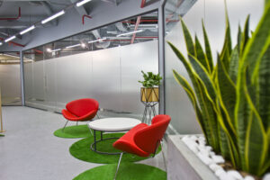 office sitting area lined by plants